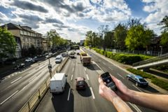Optical sensors attached to a smart phone to measure pollution
